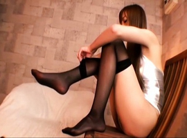 Japanese AV Model puts her stockings on man and touches his penis