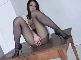 Ryu Asian doll with specs shows sexy legs in black stockings