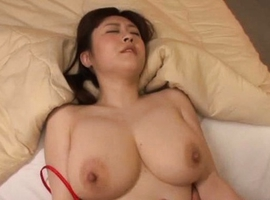 Amateur Japanese babe exposes her big tits for a fondling