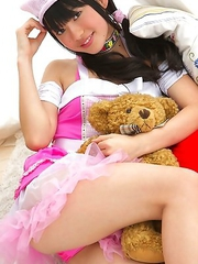 Tomoe Yamanaka in pink maid uniform plays with teddy bea