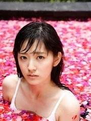 Airi Suzuki in bath suit enjoys petals all over her body