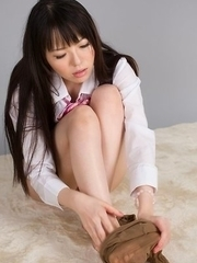 Horny schoolgirl Yuma Miyazaki shows off her feet before using a vibrator on cam
