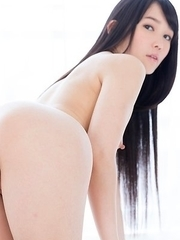 Yui Kasugano posing in sexy white high heels while showing her ass and pussy