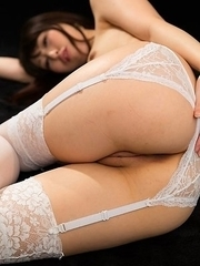 Miku Oguri posing in white stockings and giving all sorts of hot leg/footjobs